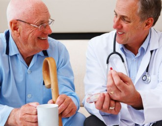 Senior man smiling and talking with doctor