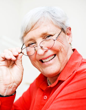 Senior woman smiling and looking over her glasses