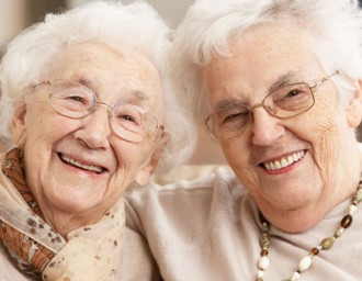 Two senior women, smiling